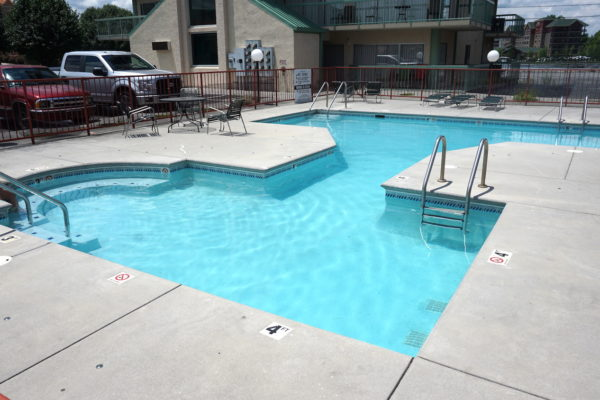 Outdoor swimming pool at River Place Inn Pigeon Forge Tn