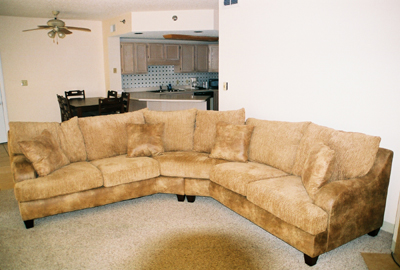 Sofa in living room with kitchen and dining area in Pigeon Forge Tn