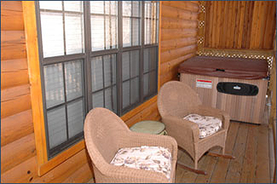 two chairs and hot tub on the deck of a Pigeon Forge cabin
